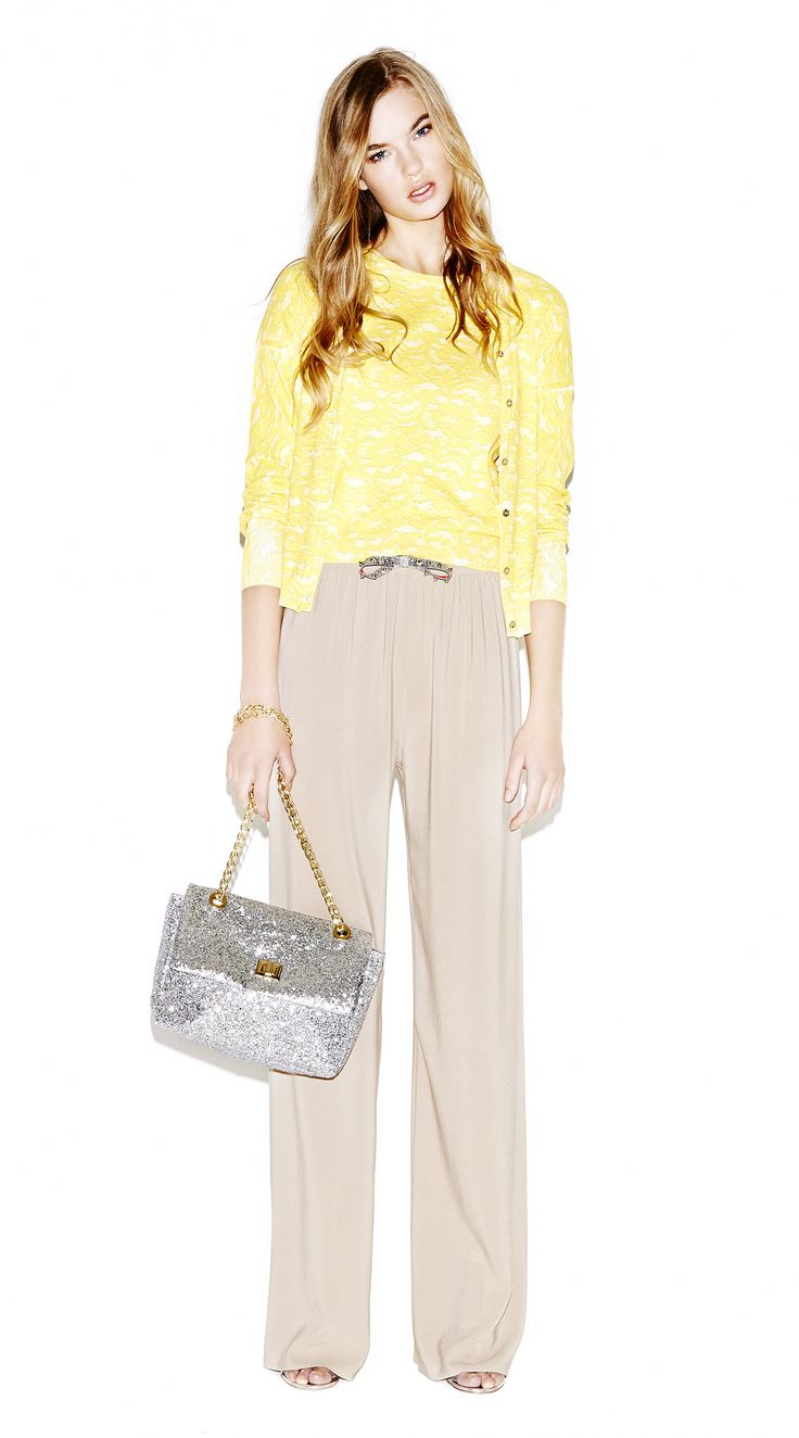 Model wears Naughty Dog printed cotton blouse with its matching cardigan; wide leg silk pants; adjustable glitter belt and a glitter bag with jewel locking.