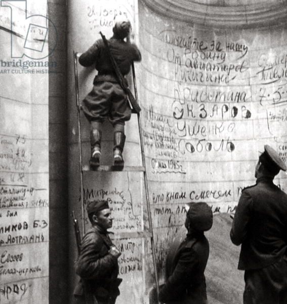 Soviet soldiers writing on the walls of the Reichstag (b/w photo) 1945 Berlin.