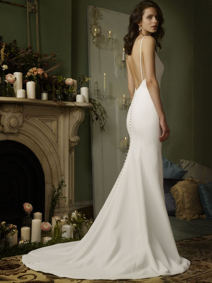 Low V-neck Four-ply Crepe modified mermaid gown with buttons to hem. Separate overskirt available for purchase.
