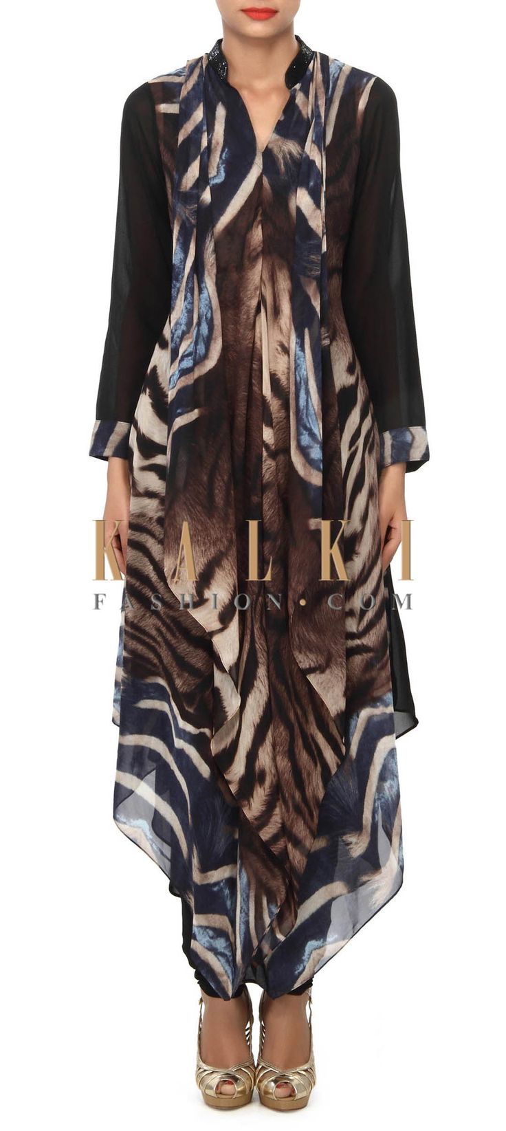Buy Online from the link below. We ship worldwide (Free Shipping over US$100) Price- $99 Click Anywhere to Tag http://www.kalkifashion.com/printed-kurti-enhanced-in-animal-print-only-on-kalki.html