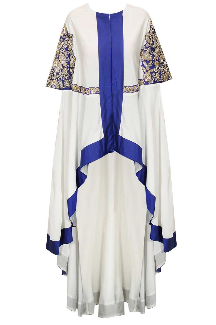 White and blue embroidered cape with blue pants by Sonali Gupta. Shop #sonaligupta #cape #pants