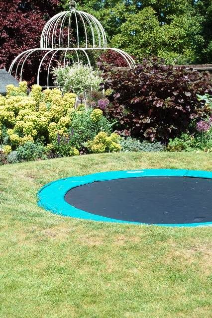 Great idea!!!! a sunken trampoline. Still would want the fence around it