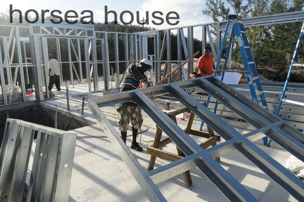 set up steel frame construction house