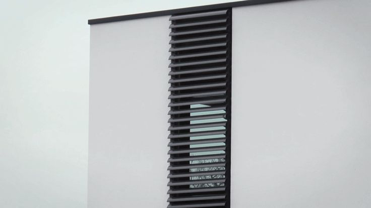 Watch The Folding Shutters On This House Open Vertically