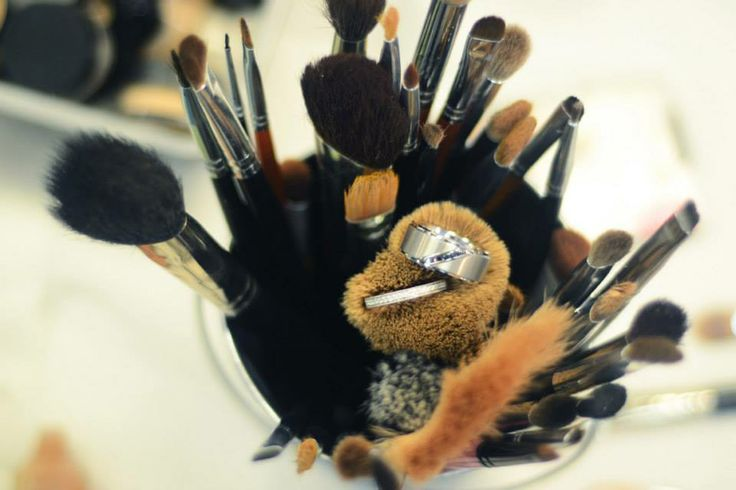 Our wedding rings in the make up artist's brushes