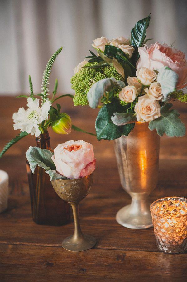 romantic centerpieces, photo by Next to Me Studios http://ruffledblog.com/san-diego-loft-wedding #gold #centerpieces #flowers