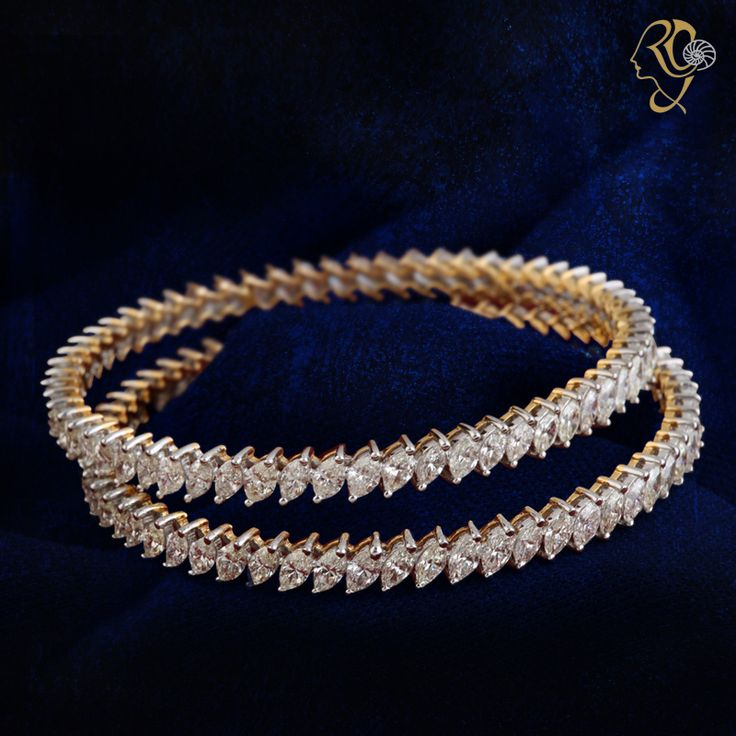 #marquise single-line #bangles made of  waves of brilliant diamonds interspersed with beats of #gold #JewelryDesign