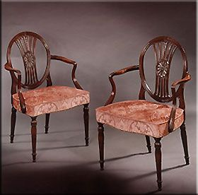 Robert Adam-In Adam chairs, which are mostly of square form, small panels in the top row are noticeable. Griffins are sometimes introduced between the splat and the seat. There is also some low relief carving of classical designs. Classical figures form the supports of the roll back arms of chairs. Chair legs became round or square, tapering downwards, often fluted. The feet are a elongated bulb foot