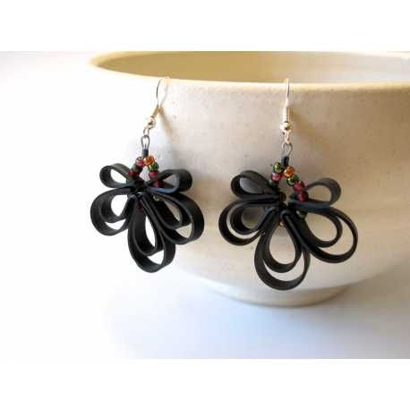 These earrings are made and designed by me from upcycled bicycle tubes. I use thin strips of inner tubes and combine them with glass beads for a unique look. No two sets of earrings are alike because no two people are alike and no two days are alike and no two.....you get the idea.  By Sarah's Bike Tube Jewelry