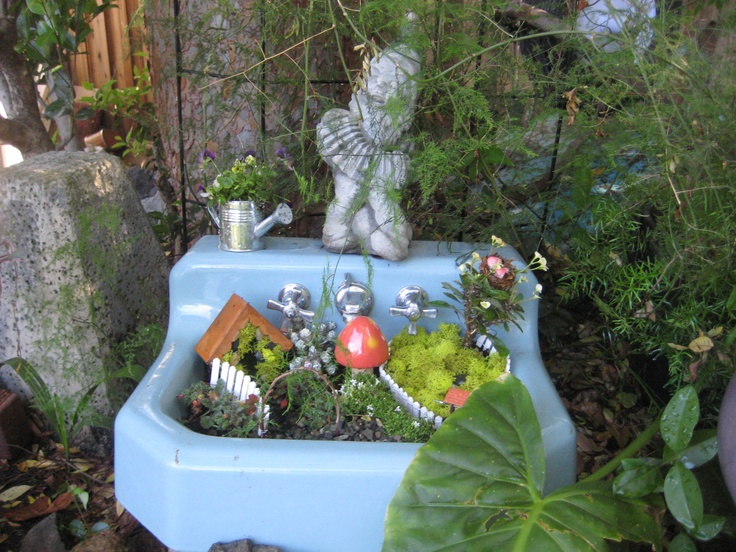 A simple fairy garden in an old 50s sink Garden and