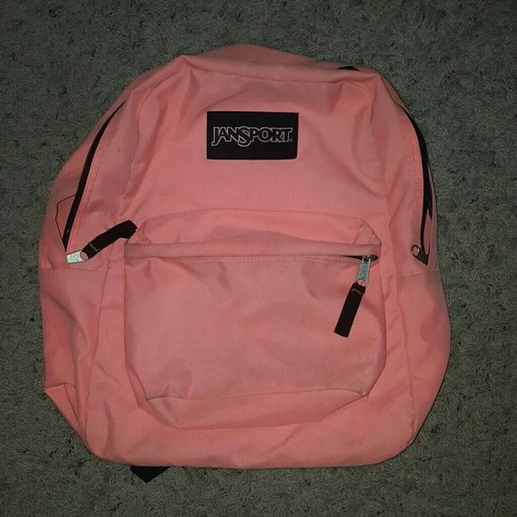 Pink Jansport Backpack Bookbag This bag was used, but it does have a pen mark on it that would likely come out with a wash. Jansport Bags Backpacks