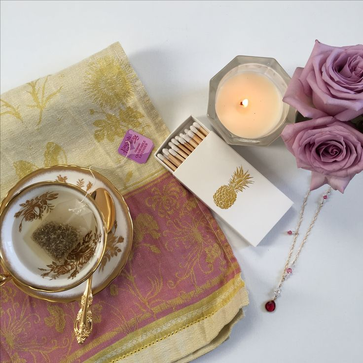 A relaxing cup of tea, fresh roses, soothing aromatherapy candle and sparkle