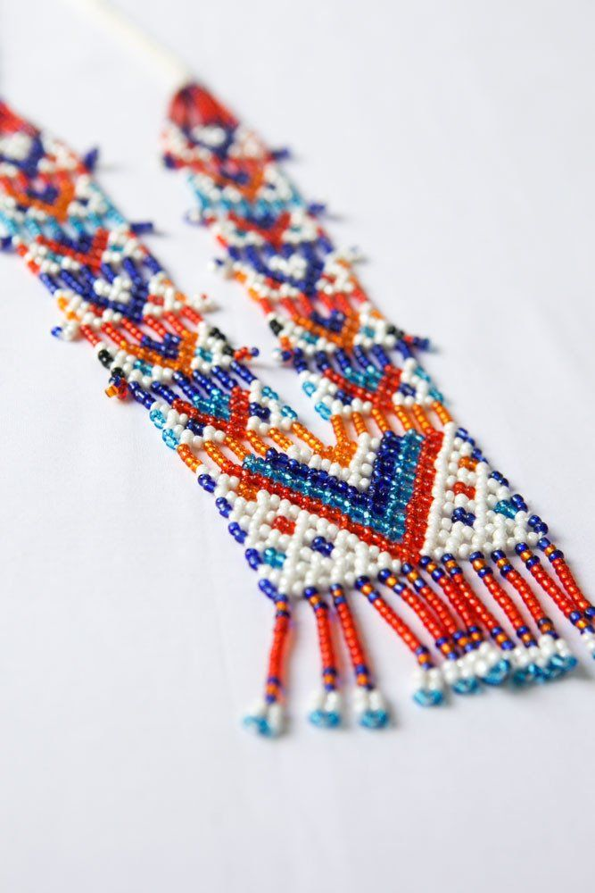 This beautiful glass bead and wool tassel necklace was hand made by Kalbelia Gypsy women, Moria (in pink), her sister Anita and mother Suha. Women in the Kalbel