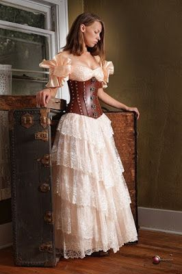 From the Steampunk Fashion Guide to Skirts & Dresses: Tiered Skirts - An example of a woman dressed in a victorian style long lace tiered ruffle skirt