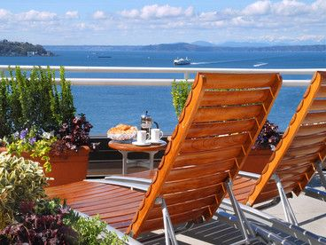 "Readers' rating: 81.397  An inn only by name, this boutique hotel, perched on a hilltop in Pike Place Market, is a chic stay ""in the heart of quintessential Seattle"". Minimalist rooms with bay windows offer unbeatable views of the market, the ferries cutting across Elliott Bay, and on a clear day, the Olympic mountain range. An ivy-draped inner courtyard is home to Bacco, a popular happy hour spot; nearby, Café Campagne hosts a spirited Bastille Day party every year."