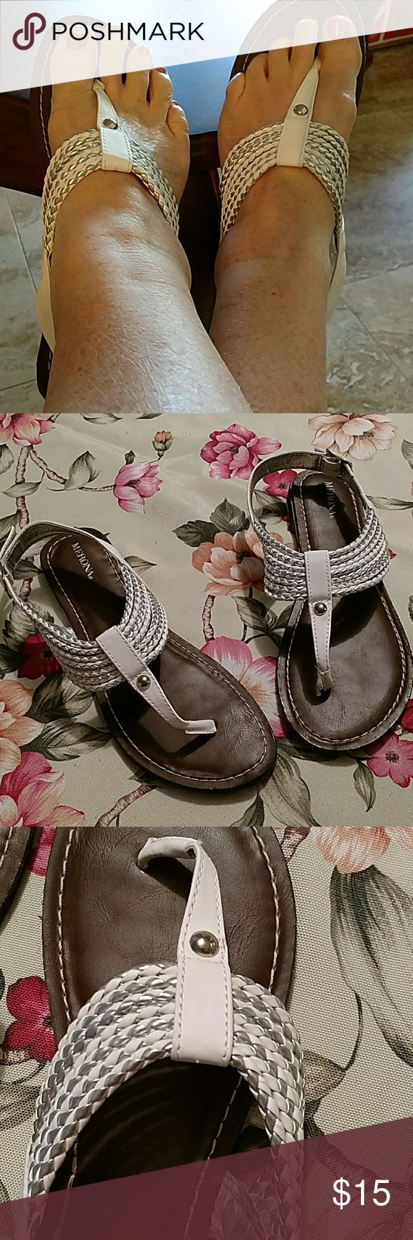 Merona white and silver flat sandals, size 9 Super cute thong style sandals with adjustable back strap. Seven leather straps of white and silver leather. NEVER WORN! Merona Shoes Sandals