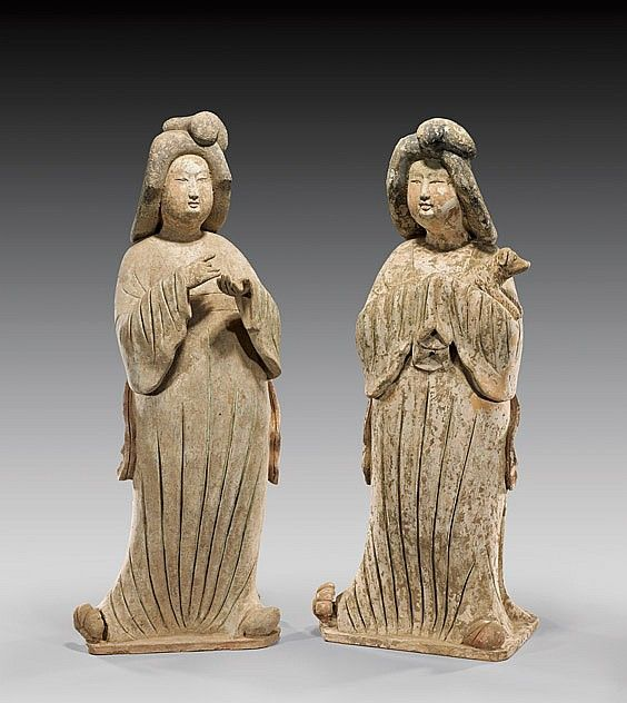 "PAIR TANG POTTERY COURT LADIES Pair of unusually large and finely modeled, Chinese Tang Dynasty painted pottery figures of court (""fat lady"") beauties: each in draped conforming robes and with stylized hairdos; one with finely featured hands gesturing; the other cradling a small dog with hands hidden in sleeves, one slightly taller than the other (usual repairs); H: 32"" (taller); with C-Link Research & Development TL Test Reports: # 179TL08 and 6236UA08"
