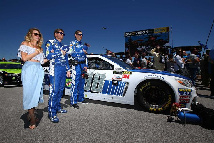 Talladega weekend:    By NASCAR.com | Sunday, May 7, 2017  -  Dale Earnhardt Jr. gets ready to race on the grid with wife Amy and crew chief Greg Ives  -    Photo Credit: Getty Images  -    Photo: 49 / 91