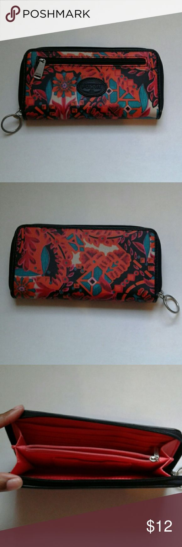 Fossil Wallet Fossil Wallet with a zipper pocket on the front  Colors: black, orange, green.  Small spot in last picture.  Good condition Fossil Accessories