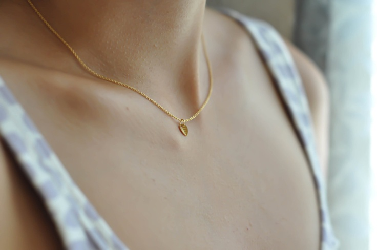 Sweet Lucy–Tiny Leaf Charm on a Gold Filled Chain, Simple Gold Necklace. $17.00, via Etsy.