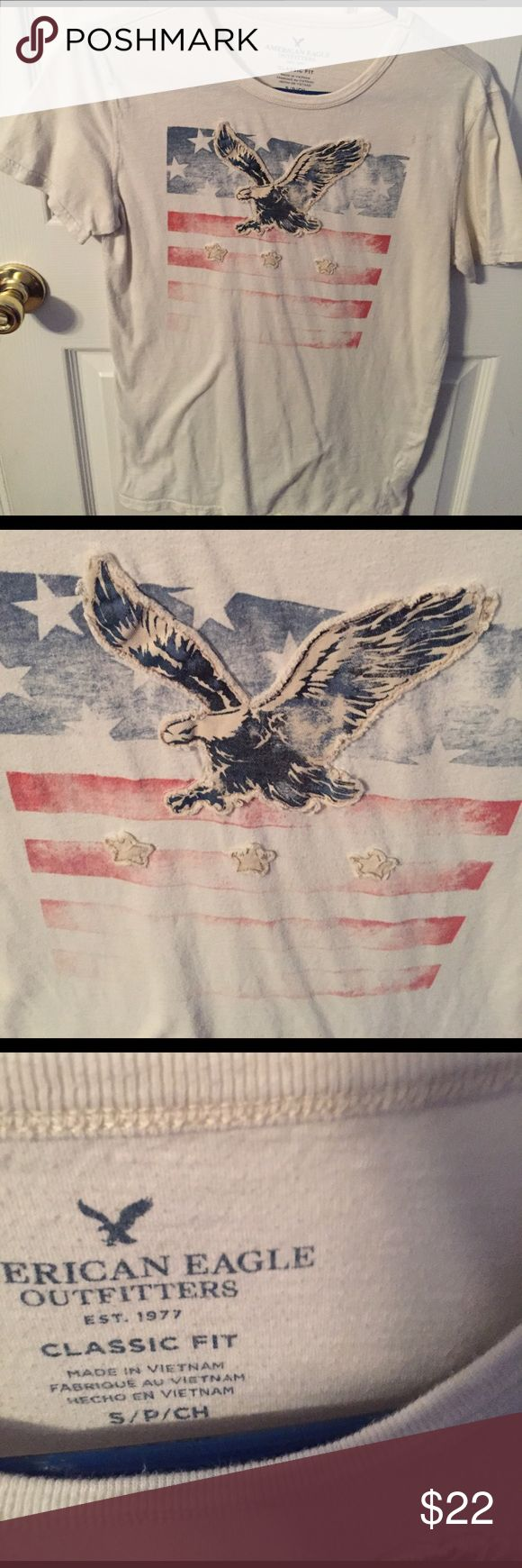 American eagle shirt American eagle shirt with American flag on front. Off white color. Small stain near top left shoulder. American Eagle Outfitters Shirts Tees - Short Sleeve