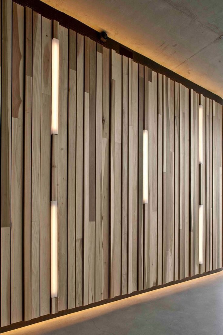 Vertically arranged woods that is lighted gives this modern vibe to this room…
