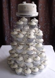 silver and white cupcake tower with top cake tier