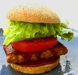 Barbecue Tempeh Sandwich: Sample recipe from the 30 Minute Vegan cookbook by Mark Reinfeld and Jennifer Murray. Tempeh makes a rockin' veg sandwich! And 30 Minute Vegan's BBQ Sauce gets rave reviews from countless satisfied customers. You can also serve the cutlets over quinoa, rice or other grain, and top with the BBQ sauce.