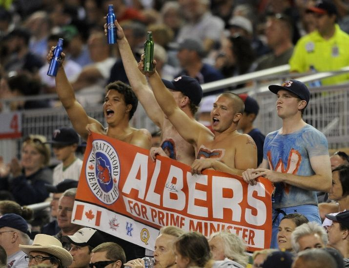 Fans cheer as Andrew Albers #63 of the Minnesota Twins walks off the field following the top of the seventh inning of the game against the Cleveland Indians on August 12, 2013 at Target Field in Minneapolis, Minnesota. The Twins defeated the Indians 3-0. (Photo by Hannah Foslien/Getty Images)