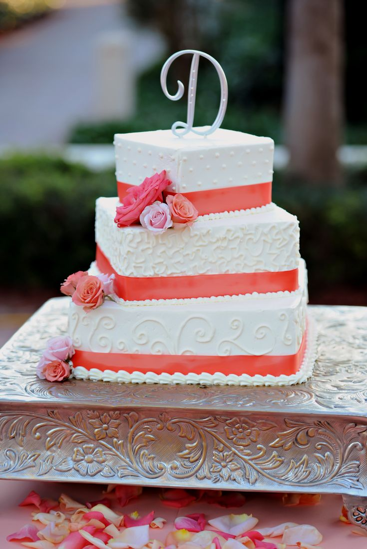 Casey- I was thinking just 2 tiers and round but I like the simplicity of this design! Tiered Square Wedding Cake with Coral Accents