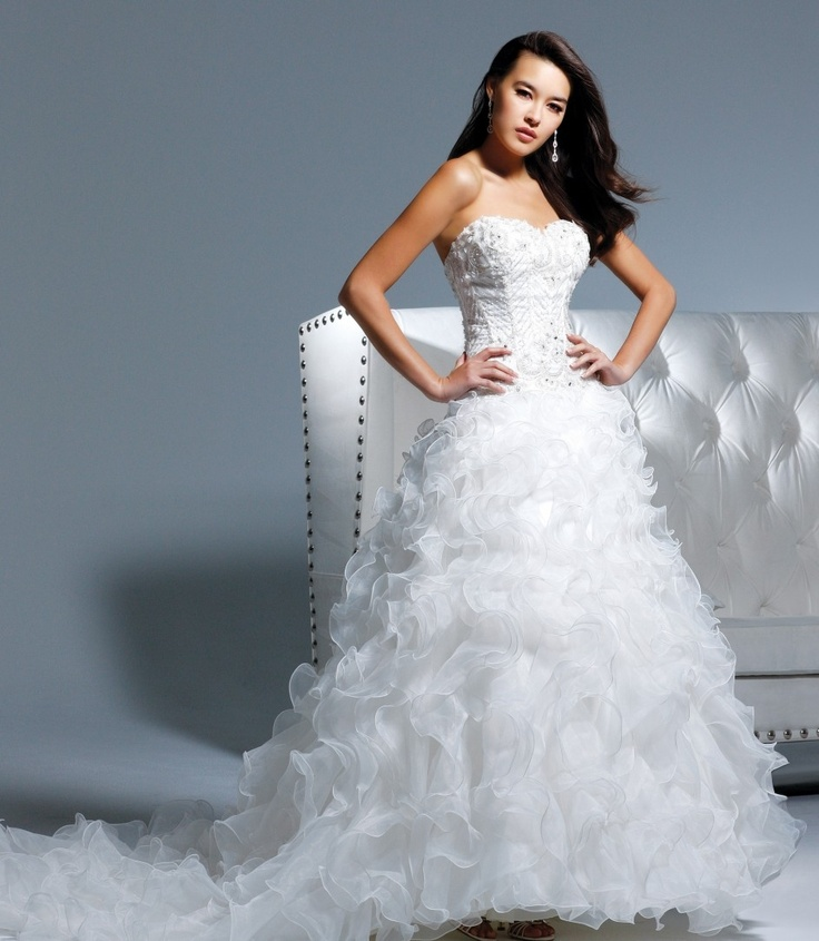Faviana - Strapless drop waist ball gown with sweetheart neckline and corset closure. Beaded and embroidered bodice with ruffled skirt.