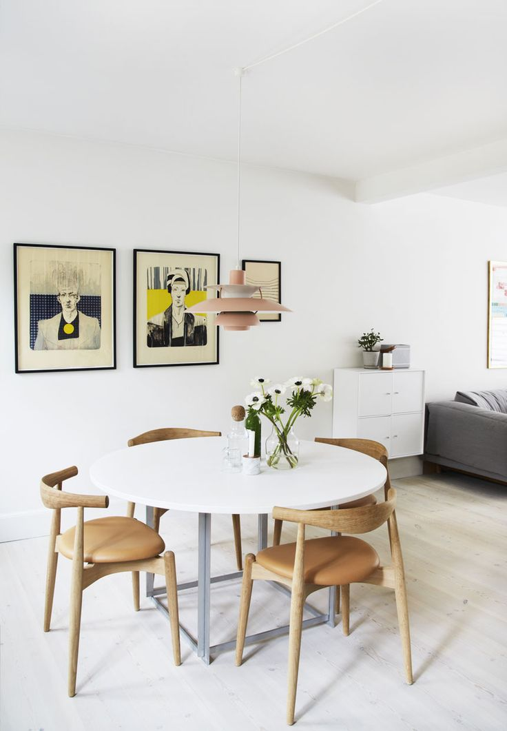 Dining area with lots of space around, in light colours and a soft theme.