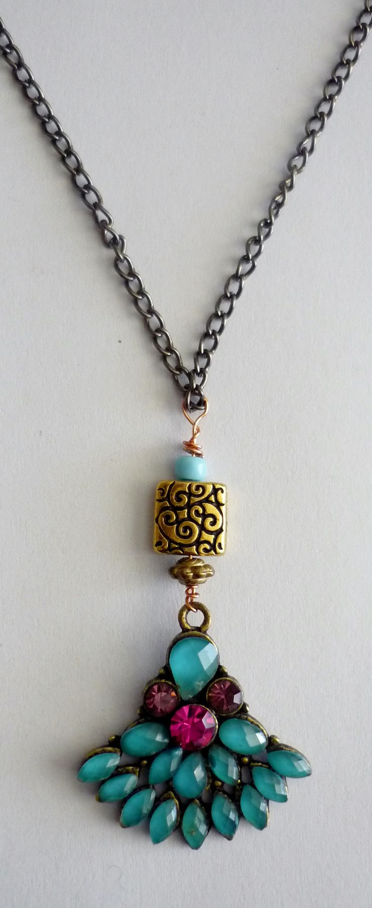Amanda Harris Turquoise/pink beaded fan shaped pendent with small gold square connector on fine nickel chain