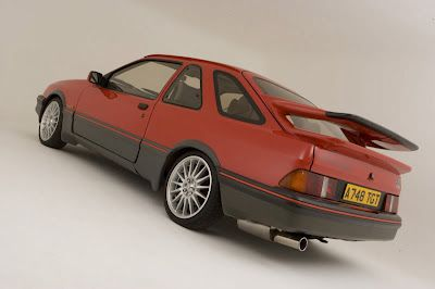 Start with one of these XR4i shells this colour combination and stripped of engine and running gear and stripped and caged interior. And widened/box arches for the exterior.