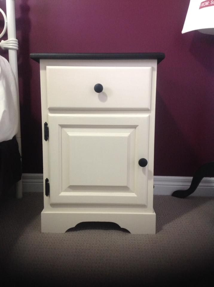 Lovely solid pine night stand with cupboard and drawer. Finished in Fusion Mineral Paint Limestone with Coal Black top and knobs. Top with a coating of beeswax.