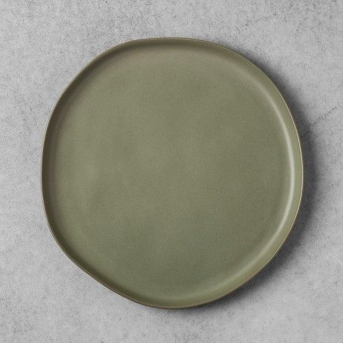 From Sunday night dinners to quick Monday morning breakfasts, the Stoneware Dinner Plate from Hearth & Hand™ with Magnolia gives the opportunity to keep your heart warm with memories and your tummy full of delicious food. Create a beautiful table setting with a few of these dinner plates, and share a meal with those who mean the most. Coming in a variety of neutral colors, you can mix and match to create a unique look that's true to you, or keep them all the same for a monoch...