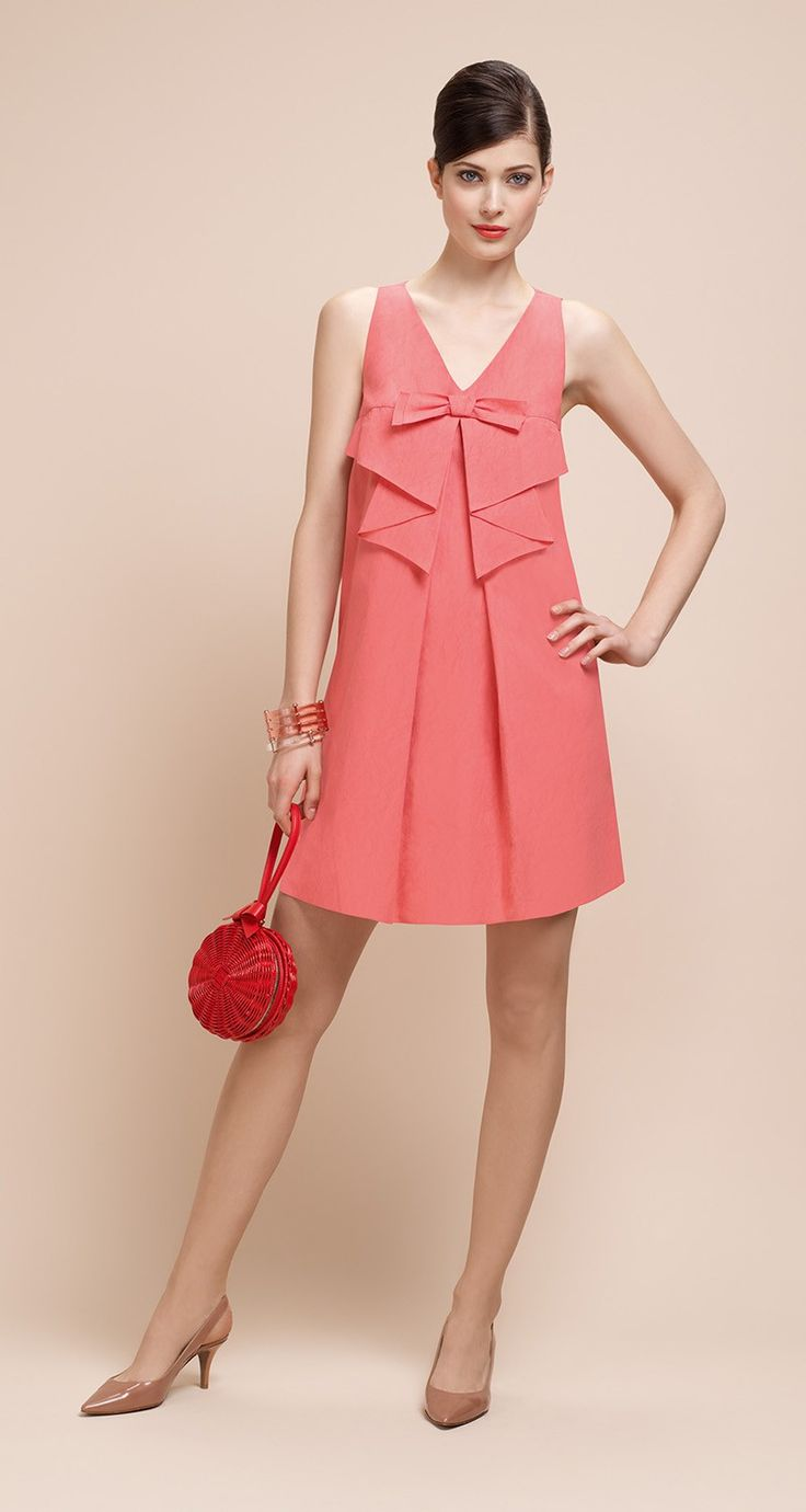 Paule Ka A-line dress with V-neck. Non-removable decorative bow on the neckline and frills. Invisible side pockets. Back zip fastening.