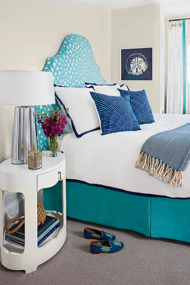 """Designer Liz Carroll kicked off the creation of this bright and happy space when she laid eyes on a bolt of look-at-me, indoor/outdoor Trina Turk fabric. She knew it would be perfect for the custom headboard, and """"it informed everything else in the room."""