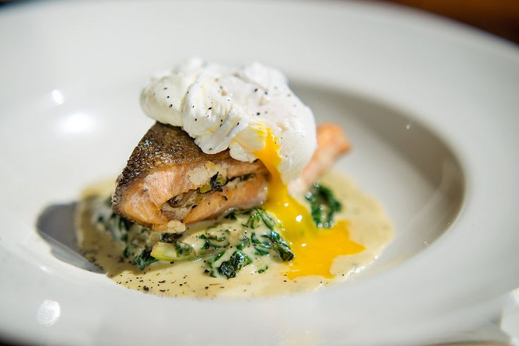 Rainbow Trout, leek and mushroom parcel, on parmesan creamed spinach, with poached egg and truffle oil.  Book info@shimmybeachclub.co.za