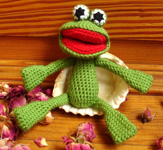 Frog Amigurumi Crochet Toy Gift Souvenir Green.  Frog amigurumi will become a wonderful gift for both the kids and the adult.  The size of the toy is 3,5x2 inches (about 9x5 cm).  The toy is made of hypoallergenic materials — microfiber (rayon), internal packing — holofayber.  The toy is made in a non-smoking room.  The toy is made with love.