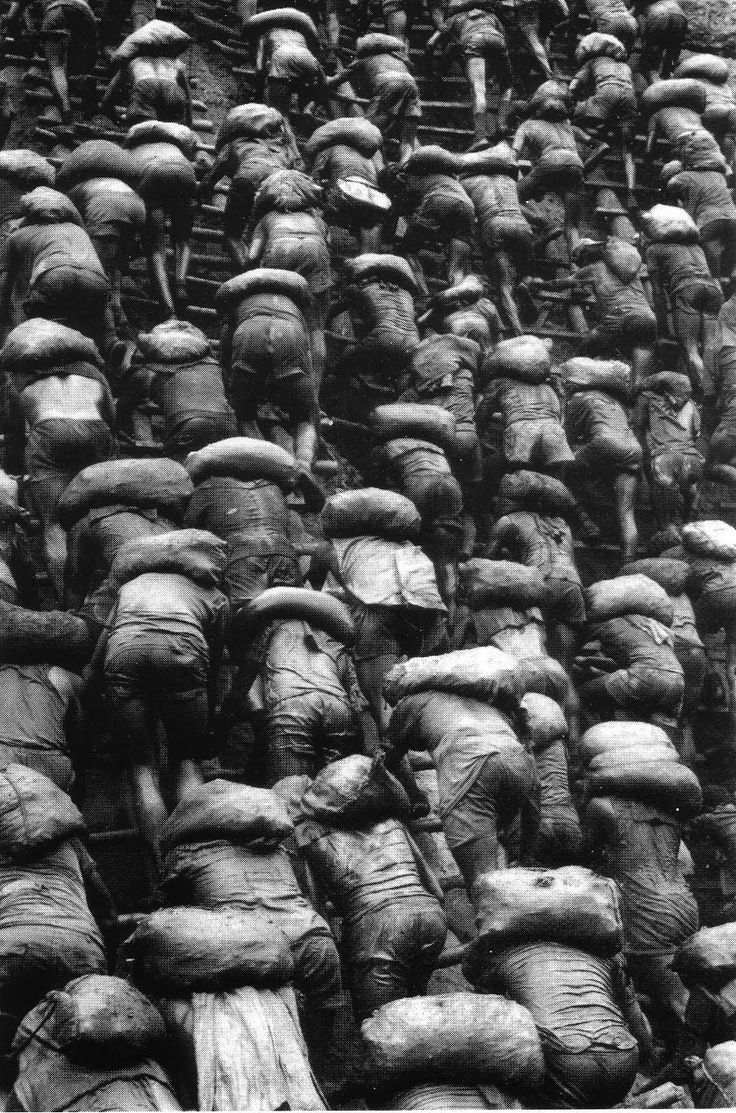 By Sebastião Salgado - This photo shows the sheer amount of people who work in the mines. It documents the daily struggle of these people and their back breaking work.