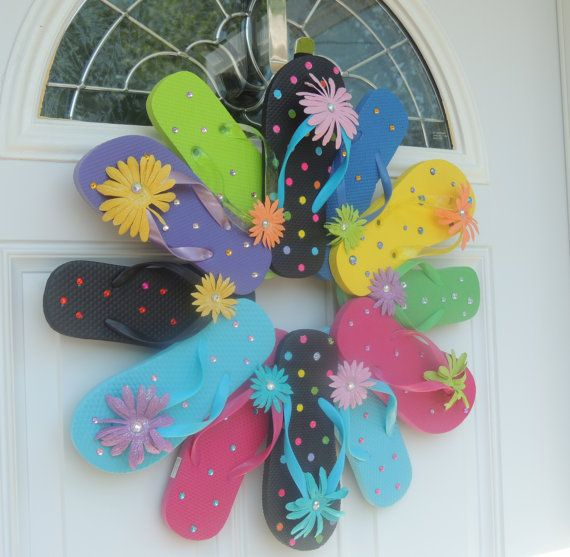 "Item Details (4) Shipping & Policies New Flip Flop Door Wreath or Wall Décor Cute NEW Flip Flops with Polka Dots and with Daisies and Rhinestones Each flower embellishment is covered in glitter This wreath has 12 flip flops and measures approx. 20""-22"" in diameter Ribbon hanger on back Handmade in smoke free home Colors will be similar to picture If you need a different size, please feel free to contact me; custom orders are welcome!"
