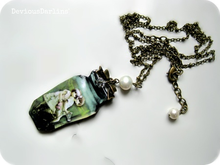Zweet Zombie Necklace <3 resin covered image with zombie children, on laser cut wood. From Devious Darlins'..