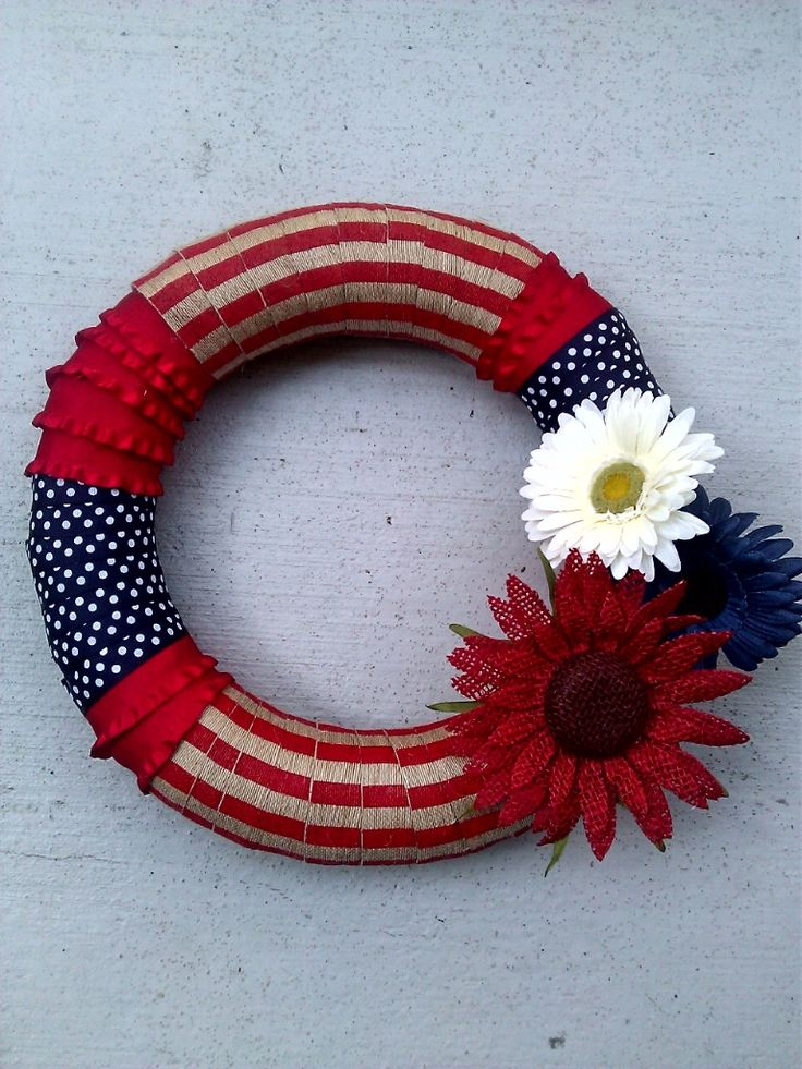 Fourth of July Wreath! So proud of myself for making this one. Just a craft store straw wreath wrapped in different ribbons, burlap and pretty flowers.