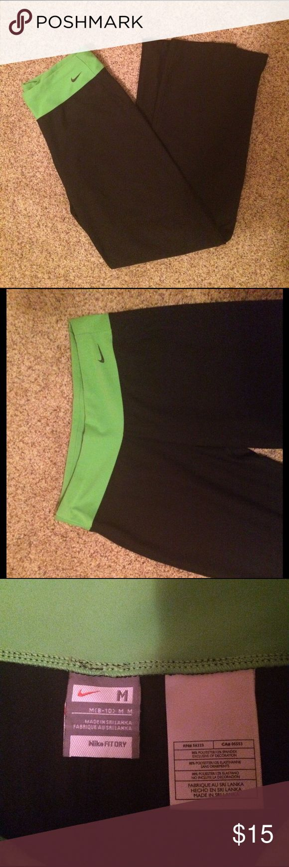 Nike Yoga Pants Straight leg elastic Nike pants, in perfect condition! 3 inch bright green waistband with black the rest of the way down. Nike Pants
