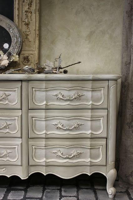Amy Chalmers of Maison Decor dry brushed Artisan Enhancements Pearl Plaster on the drawer fronts of this French Provincial dresser.