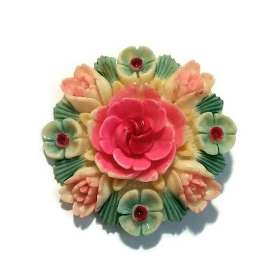 Check out this item in my Etsy shop https://www.etsy.com/ca/listing/592969039/celluloid-pink-rose-brooch-early-plastic