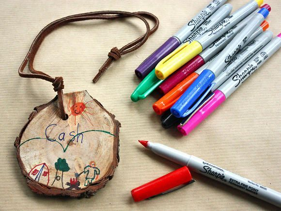 Set a table with sliced tree rounds that the kids can decorate using markers. Pre-drill a hole in each round and the kids can thread them with suede cord and wear them as pendants or use them as tags.