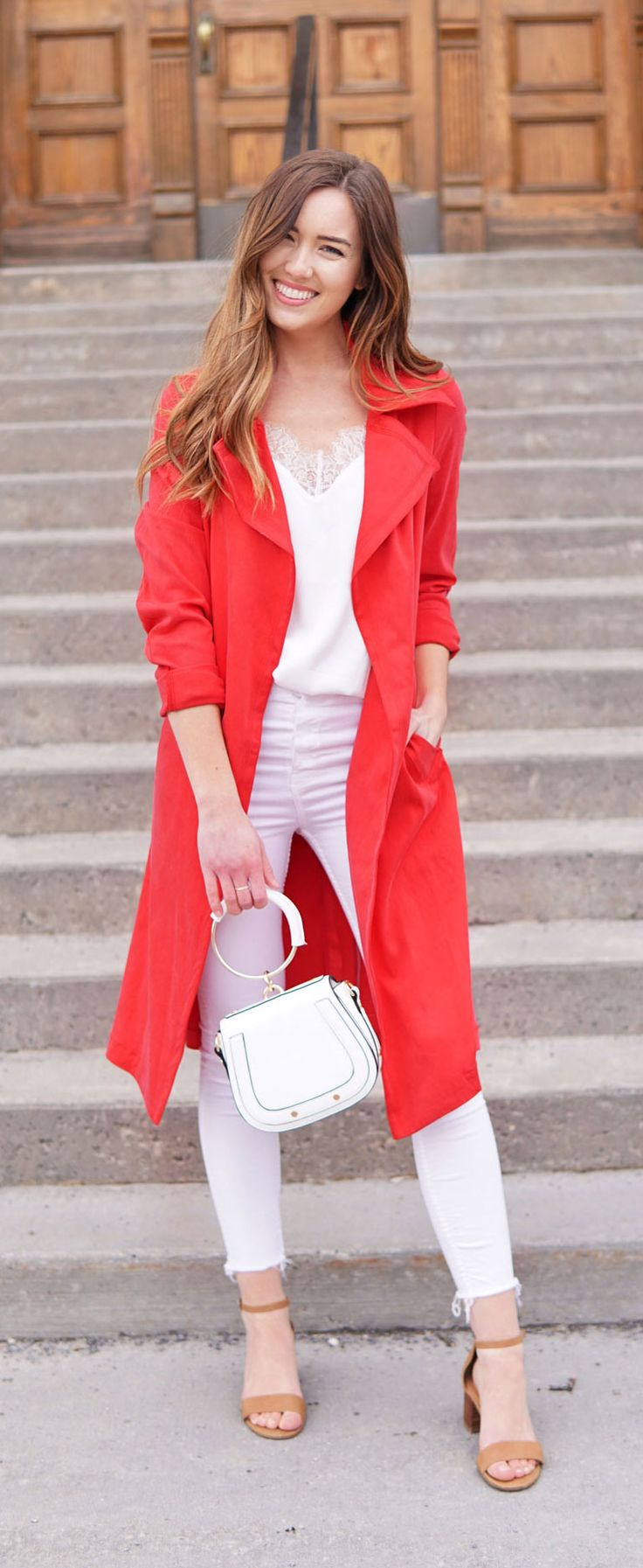 BEST RED TRENCH COAT- super affordable and soft! Marie's Bazaar wears it with an all white outfit for spring. This white lace tank top comes in 7 shades, and these are the best white skinny jeans ever - so flattering! #fashion #outfit #spring #springoutfit #whiteoutfit #whitejeans #skinnyjeans #trenchcoat