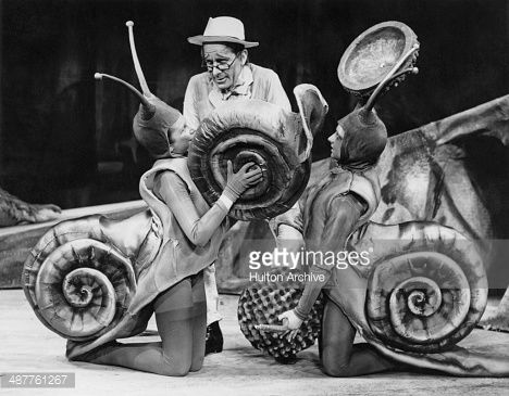 Australian tenor Raymond Nilsson as 'The Schoolmaster' with children in snail costume during rehearsals for a scene from Janacek's opera 'The Cunning Little Vixen'. This is the first time the play is...
